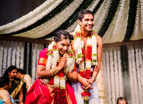 Indian couple having fun during their ceremony