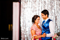Indian groom dancing with his mother