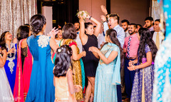 Indian wedding guest catching the bouquet