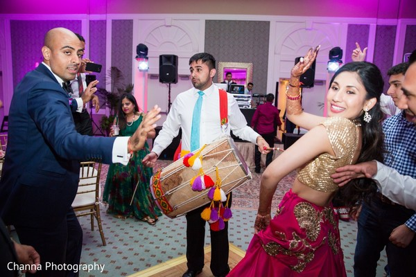 indian wedding reception,indian wedding reception photography,dhol player,indian bride and groom