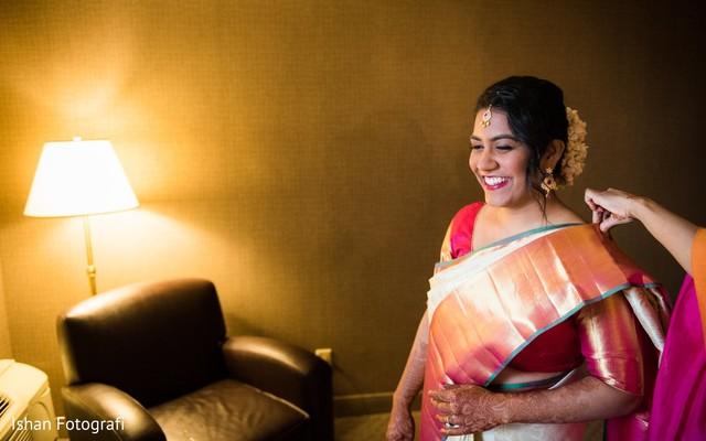 Joyful indian bride getting ready