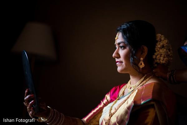 Maharani checking out her makeup
