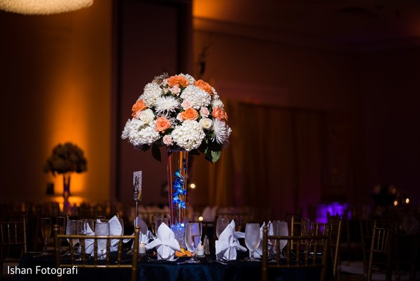 Lovely white and orange indian wedding centerpieces