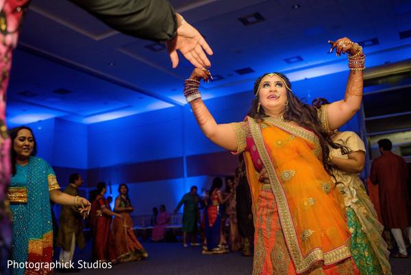 Indian bride dancing.