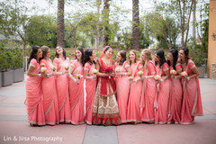 Glamorous indian bride posing with bridesmaids