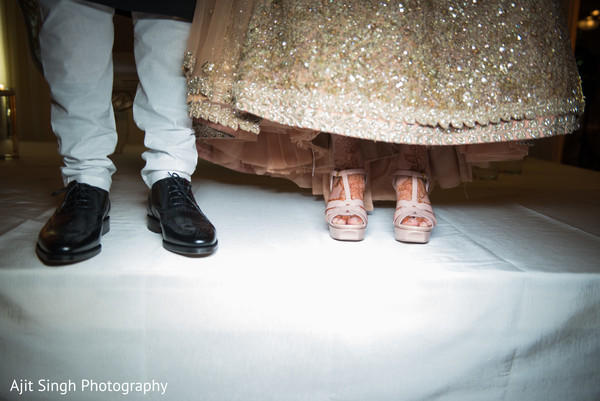 Indian bride and groom shoes close up