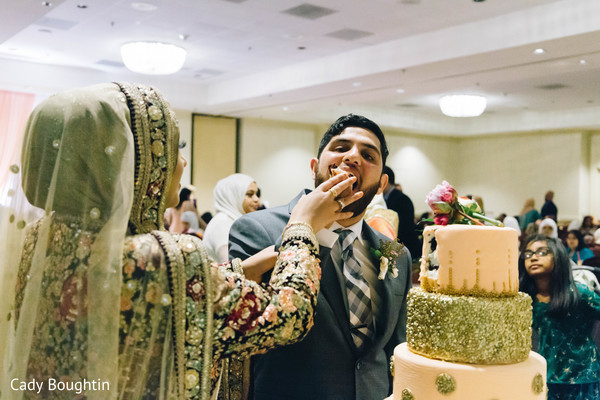 Sweet indian couple tasting the cake