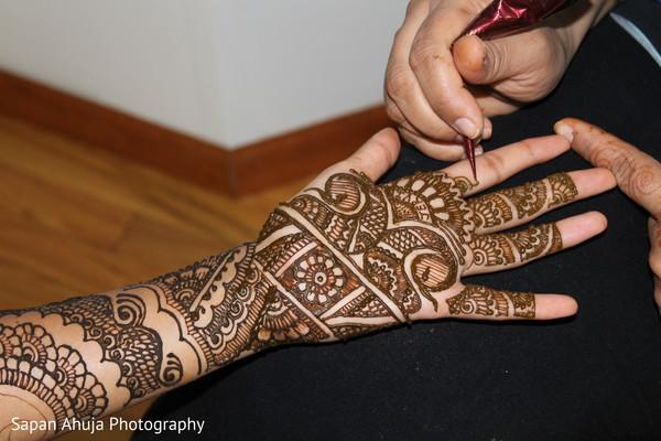 Indian bride getting mehndi art done scene