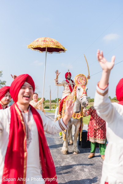 Indian groom riding baraat white horse