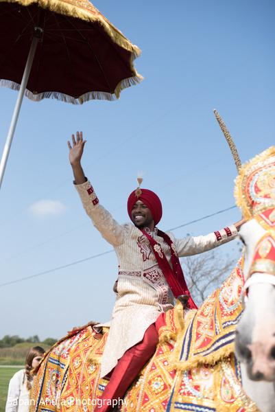 Traditional indian groom's baraat
