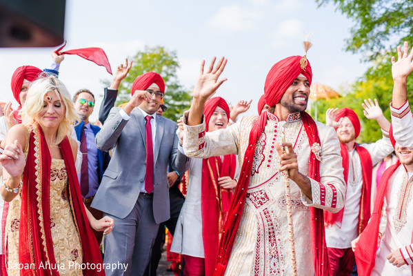 Joyful indian wedding baraat procession