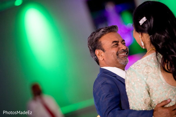 Lovely indian bride dancing with her father