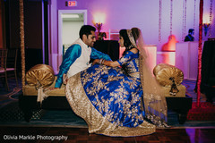 Radiant Indian bride and groom sangeet photo.