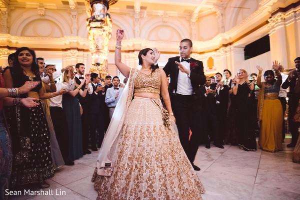 Indian bride and groom hitting the dance floor.