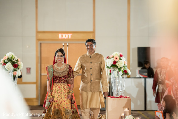 Adorable indian bride walking down the aisle