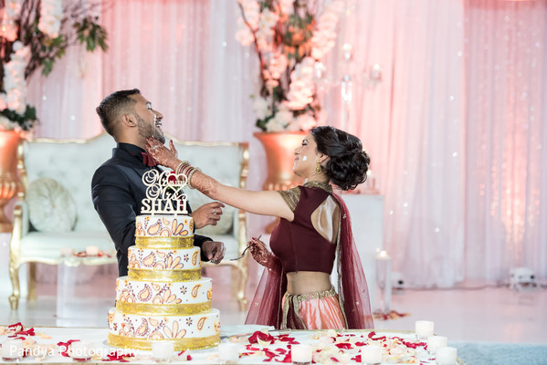 indian wedding reception,indian wedding reception photography,indian bride and groom,indian wedding cake