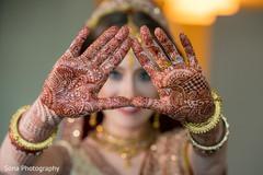 Beautiful indian bride showing henna art