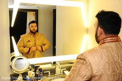 Indian groom getting ready capture