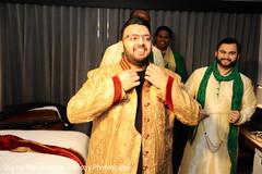 Joyful indian groom getting ready