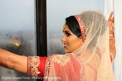 Charming indian bride looking out the window