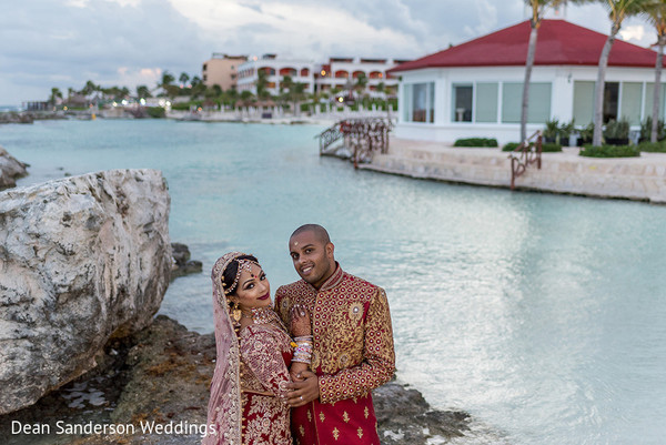 Sweet shot of Indian bride and groom at the beach.