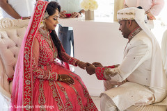Indian lovebirds exchanging rings.
