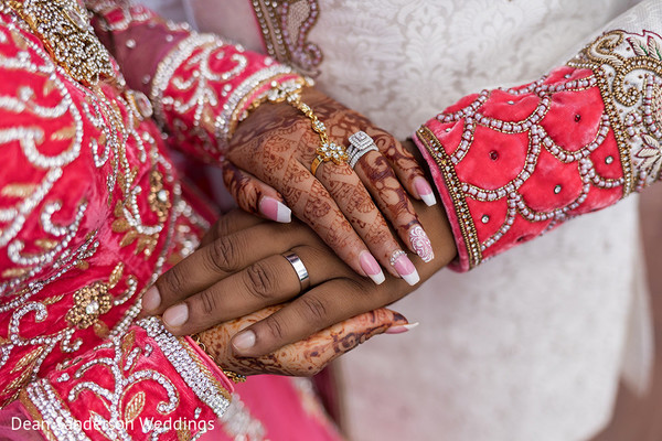 Tender Indian bride and groom capture.