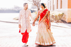 Sweet indian couple walking holding hands