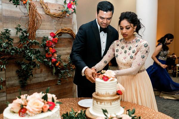 Beautiful Indian wedding cake cutting scene.