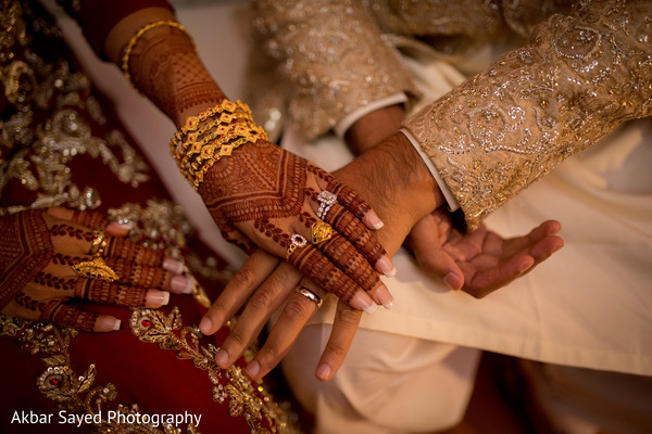 Indian bride and groom's wedding rings shot