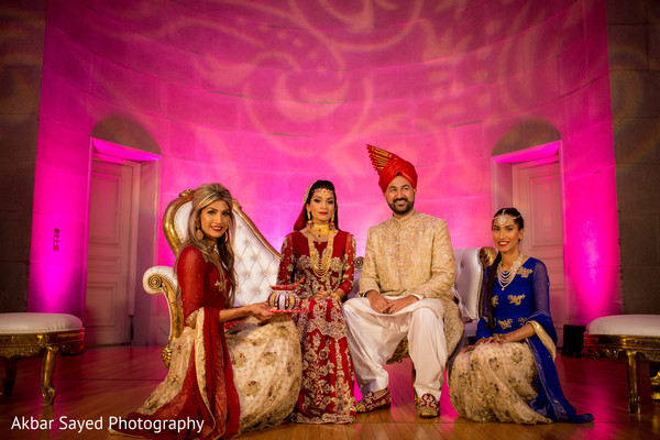 Dazzling indian bride and groom's family portrait