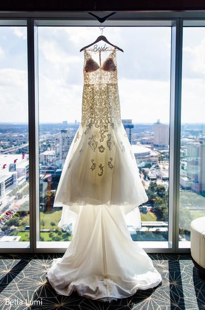 Stunning Indian bride white wedding gown.