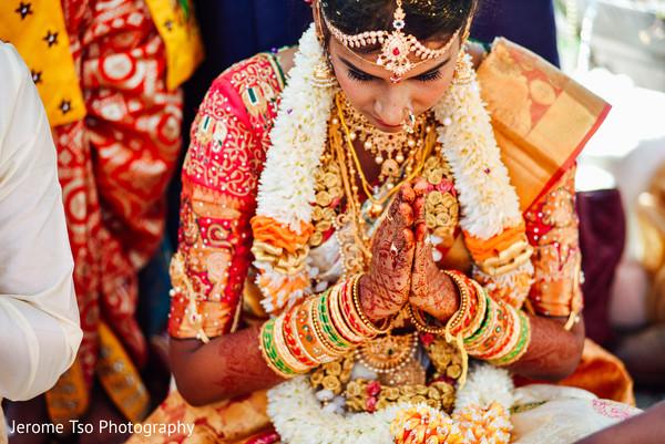 Indian bride making a prayer capture