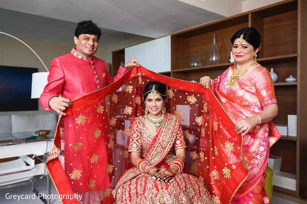 indian wedding gallery,indian bride getting ready,indian bride fashion,ghoonghat