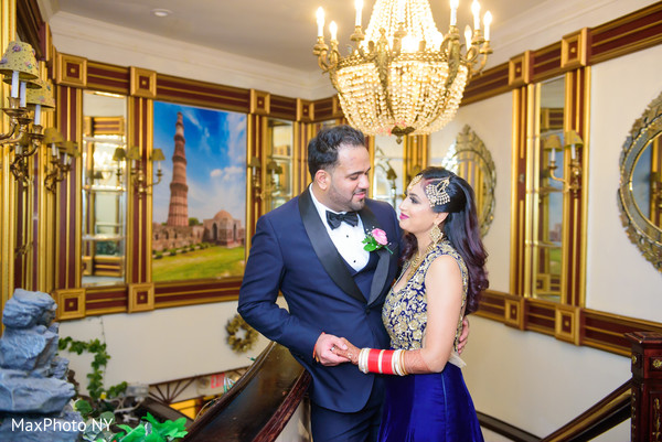 Elegant Indian bride and groom reception fashion.