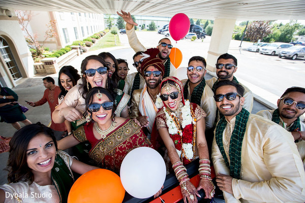 Indian bride and groom with bridesmaids and groomsmen portrait