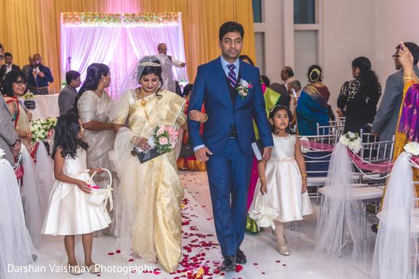Adorable indian newlyweds leaving wedding ceremony