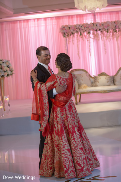 Adorable indian bride dancing with her father