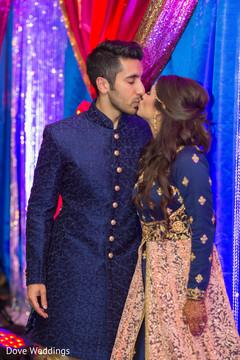 Indian lovebirds kissing capture