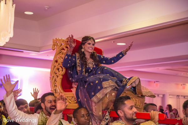 Joyful indian bride's doli entrance