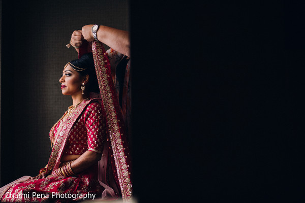 See the Final touch ups for this charming indian bride.
