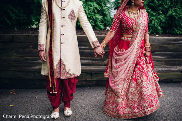 Indian bride and groom glowing in their wedding attire.