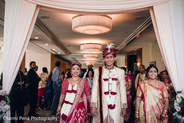 Sweet indian couple leaving wedding ceremony