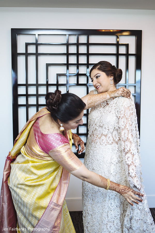 Cute indian bride being helped to get ready