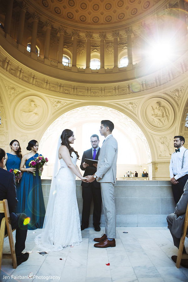 Gorgeous indian couple at their christian indian wedding ceremony