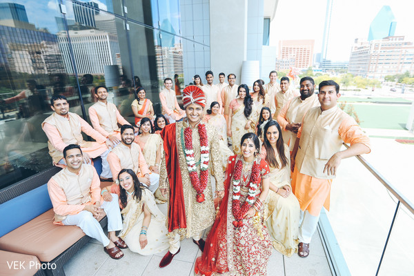 Indian bride with groom and groomsmen photo.
