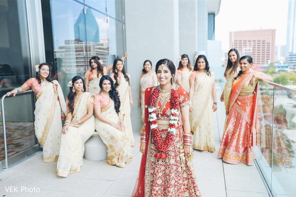 Happy indian bride and bridesmaids outdoors photo