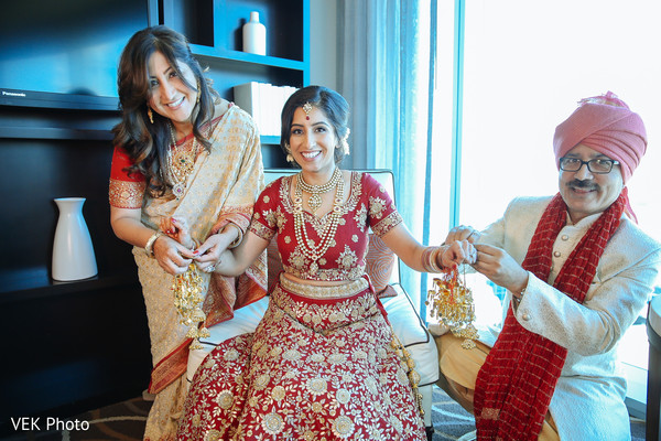 Sweet indian bride with parents capture