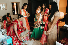 Lovely indian bride putting wedding shoes on