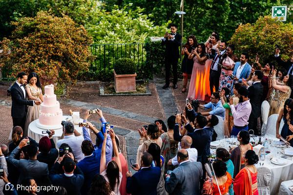 Indian newlyweds cutting their wedding cake